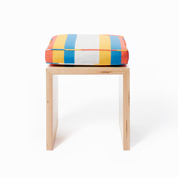 Child's stool shown with Small Stripes cushion in Surf Van.