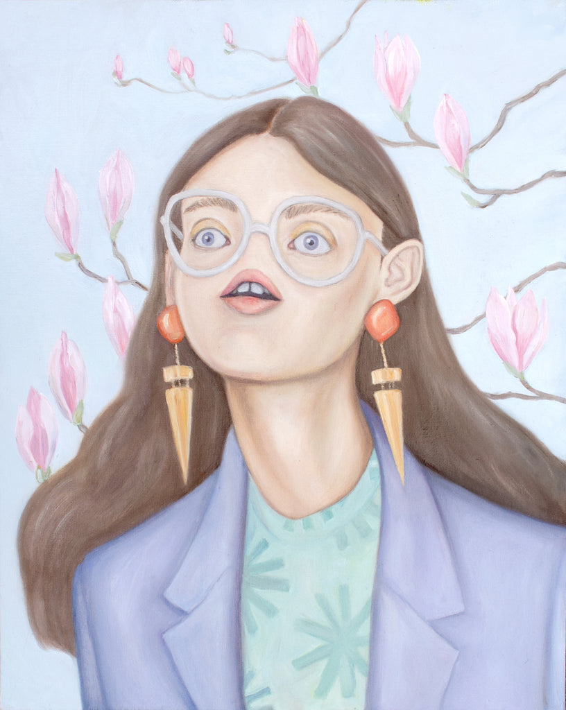 Self portrait of artist Heather Buchanan. She has no nose, but other than that she's doing fine. Pastel purple blazer, statement earrings, long brown hair. There are magnolias blooming in the background.