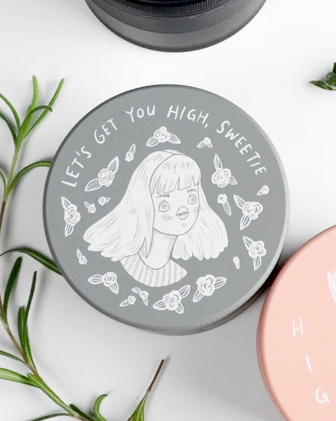 Beautiful cannabis grinder with original illustration of girl saying Let's get you high sweetie