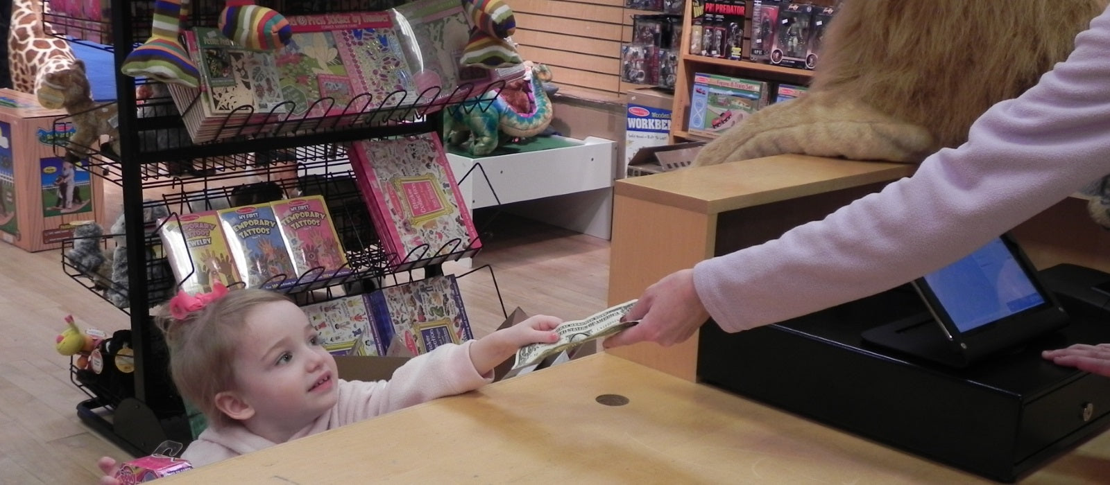 Little girl shopping at Maziply Toys & Collectibles in Kingston MA.