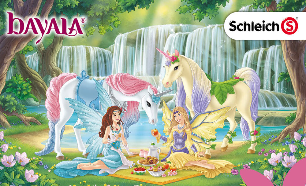 Schleich bayala scene, featuring two unicorns and two fairy princesses sitting down in a mystical forest, having a picnic.