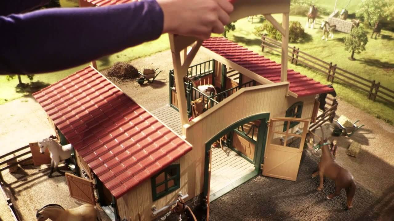 Schleich horse sets being set up in a setting with horses and custom pieces.