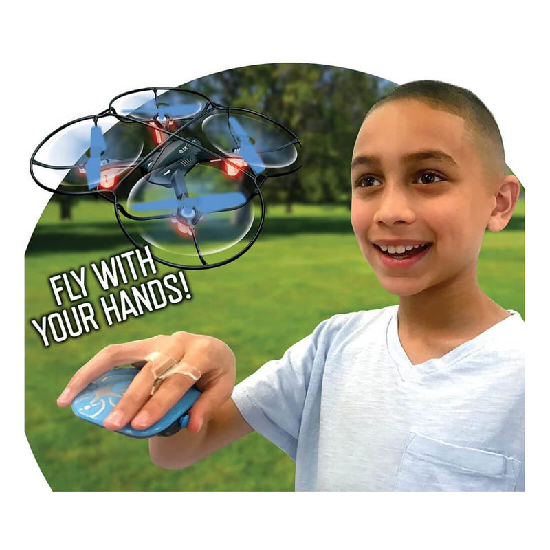 Kid playing with the drone while piloting with his hands.