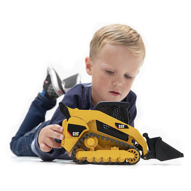 Kid playing with the caterpillar vehicle.