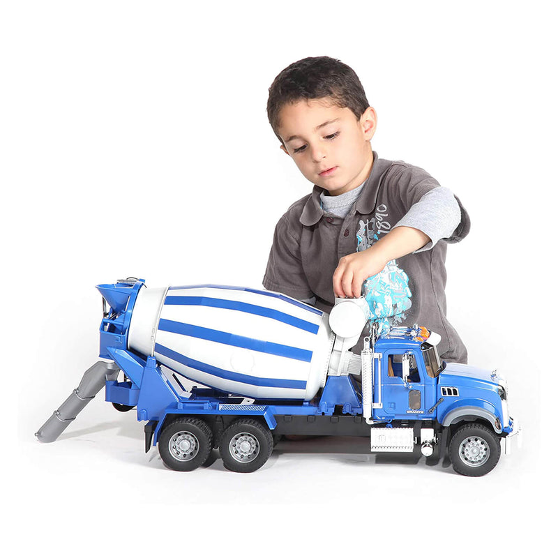 Kid playing with the cement mixer truck toy.