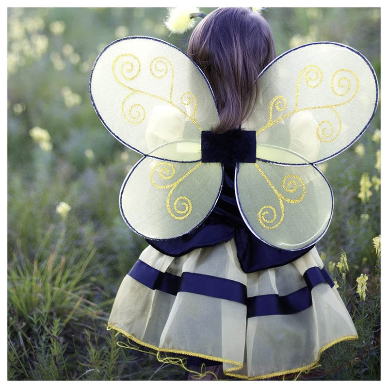 Back view of little girl wearing the Great Pretenders Bumble Bee Wings & Headband costume.