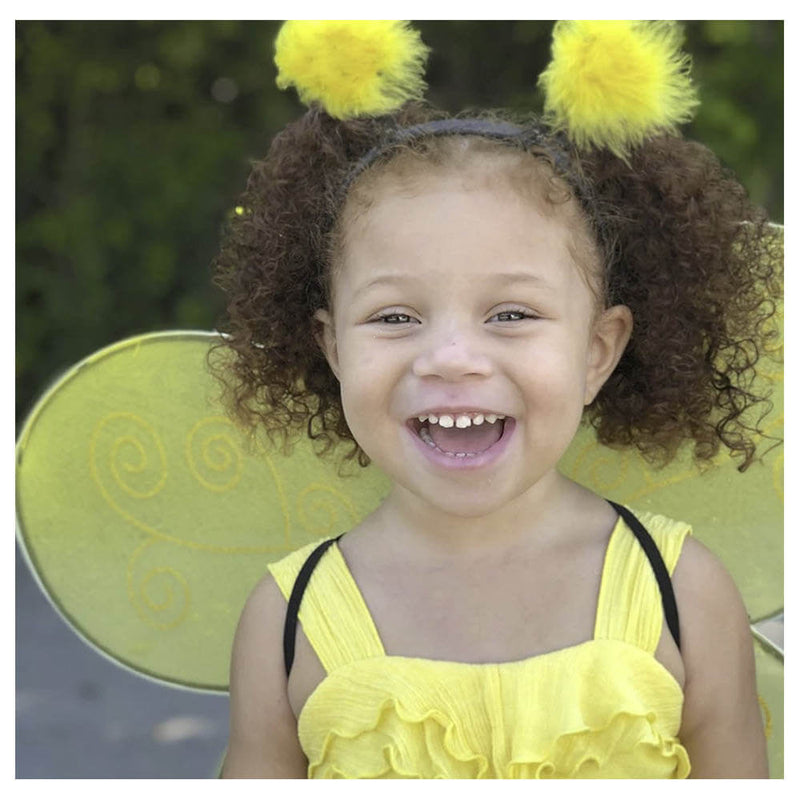 Close up of girl wearing the bee headband.