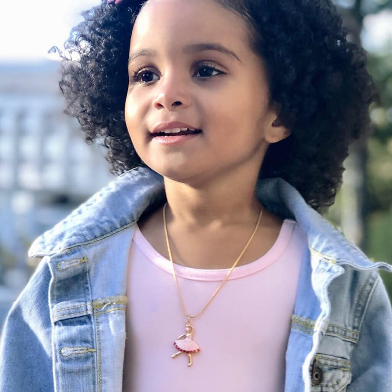 Front view of little girl wearing the Great Pretenders Ballet Beauty Necklace.