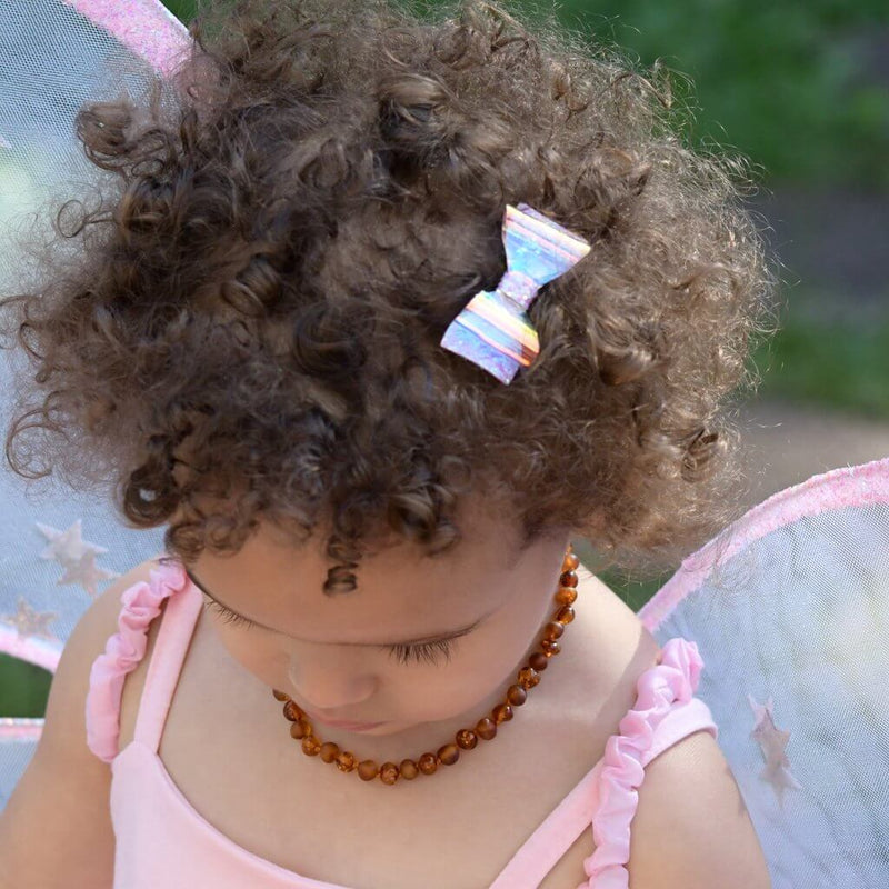 Front view of the Great Pretenders Glow Bow Hair Clips.