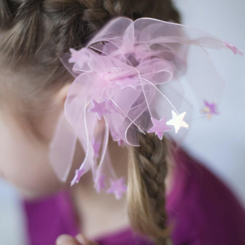 Front view of girl wearing the ponytail holders.