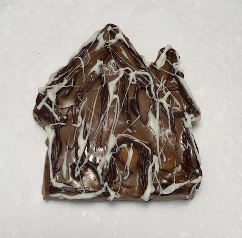 A caramel house drizzled with white and dark chocolate