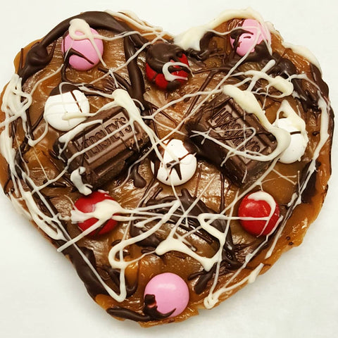 Heart shaped pizza made of from scratch caramel drizzled with chocolate