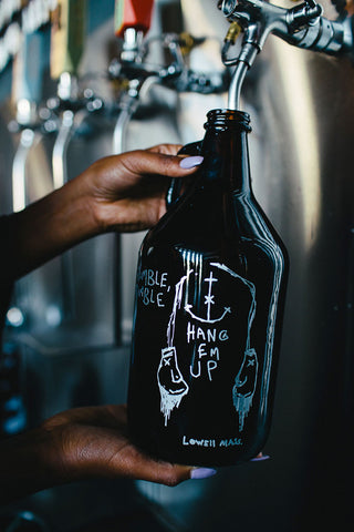 Taken from a hand drawn illustration in a note book, and brought to life on this custom engraved and silver color filled growler. One of our favorites with out a doubt.
