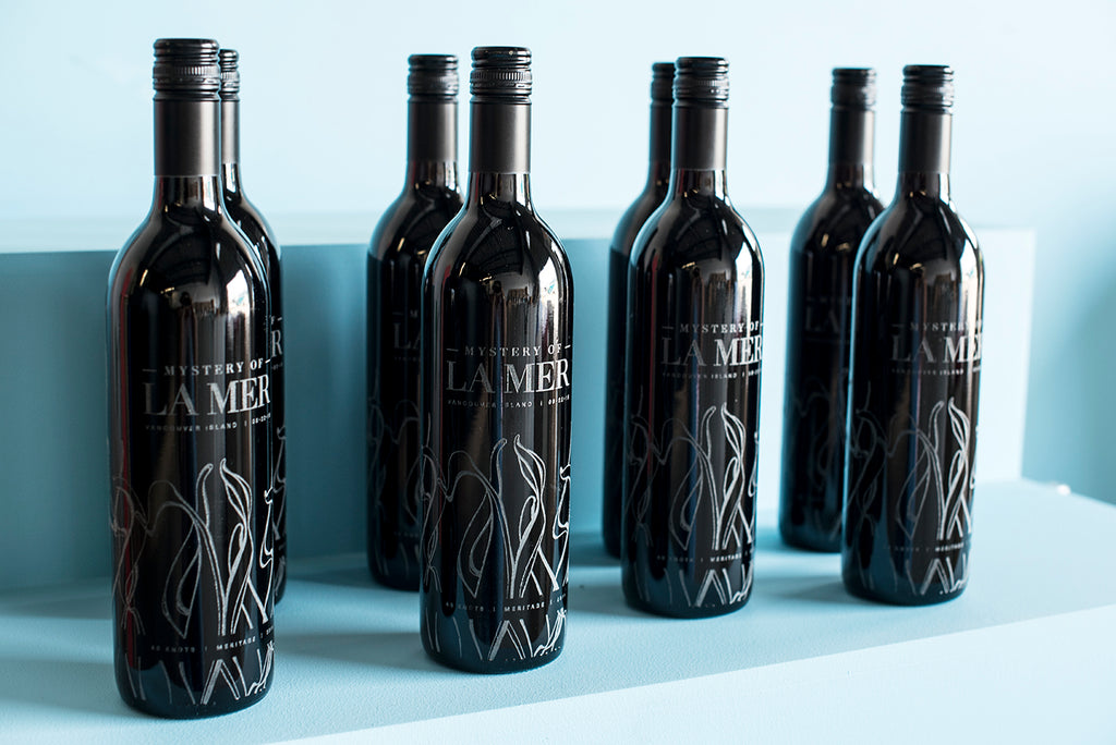 Wine bottles etched all the way around by Sigil and Growler
