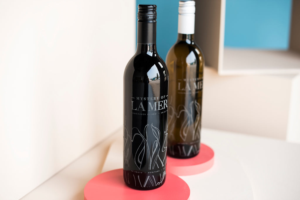 Red and White wine bottle engravings by Sigil and Growler