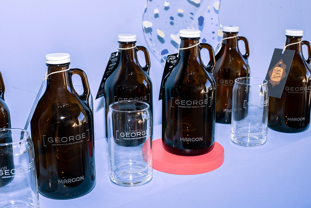 Custom engraved growlers for real estate promotion