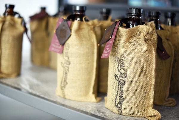 Personalized custom growler packaging ships within North America by Sigil and Growler