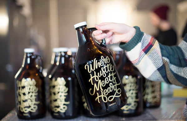 Custom typography engraved and personalized growler with a gold color fill by Sigil & Growler