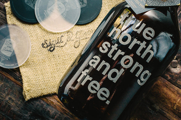 Close up of True north strong and free engraved beer growler