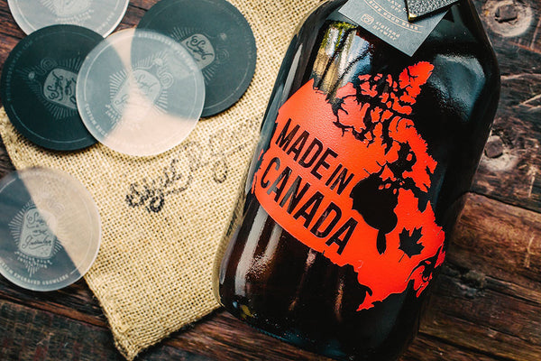 Close up of Made in Canada engraved and color filled beer growler