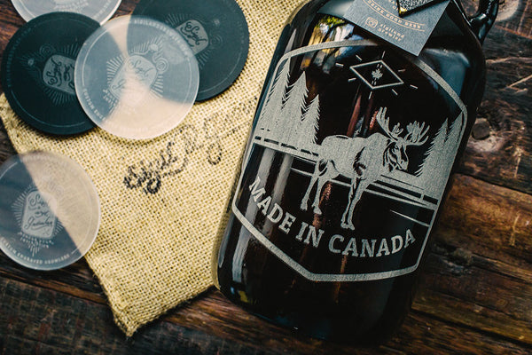 Close up of Made in Canada engraved moose growler design