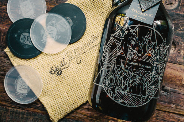 Close up of Elements Fire engraved growler design