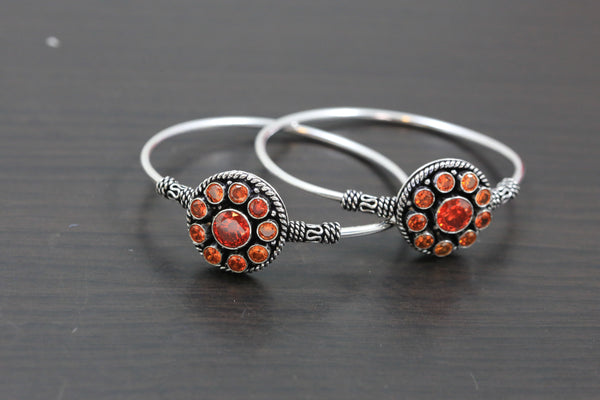 Silver Finish Orange CZ Bangle