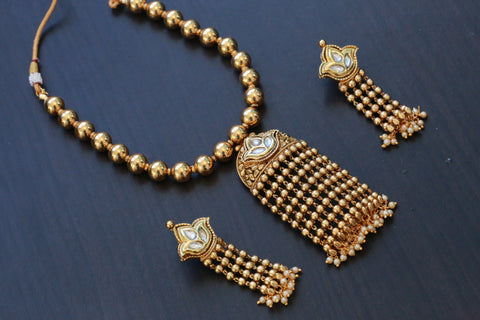 Gold Tassel Kundan Pendant Necklace Set- Clear
