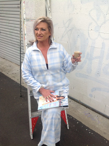 Locally made slow ethical fashion dressing gown has zip front opening high soft warn neck. Generous pockets long sleeves shown here in soft baby blue and white pattern