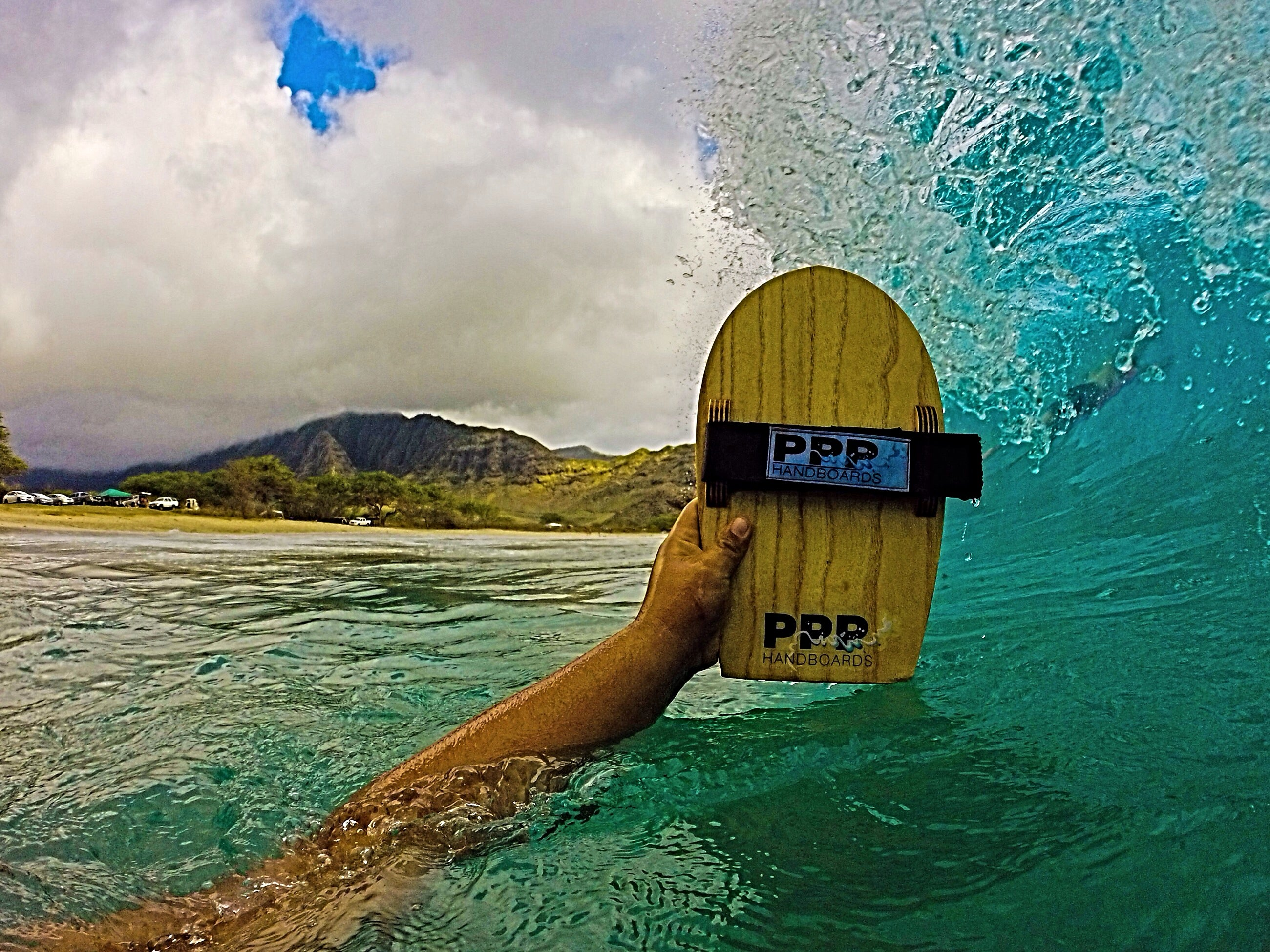 "Velo body surfing hand boards by PPP Handboards feature a mildly kicked nose, flat tail rocker, a ""high-in-the-nose-to-lower-in-the-tail"" rail line"