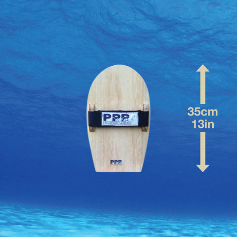 The Velo Standard bodysurfing handboard by PPP Handboards, showing its length. It is a linear planing that is made using sustainably grown paulownia wood