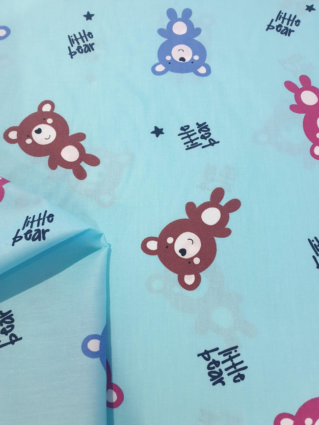 Cotton Baby Bear Fabric. Pink, Blue and Brown Bears with Small Navy Stars on Light Blue Background