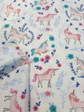 Unicorn Print Fabric on White Background With Blue and Pink Flowers