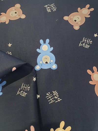 Cotton Baby Bear Fabric. Blue and Brown Bears with Small Gold Stars on Navy Background