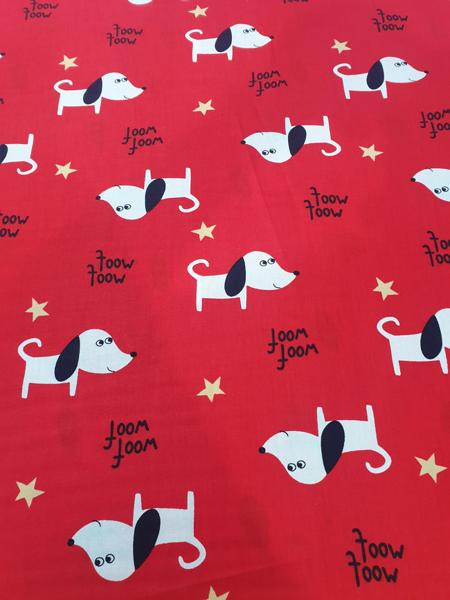 Puppy Print Fabric With Small Yellow Stars and Red Background