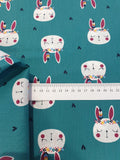 Bunny Print Fabric on Teal Background