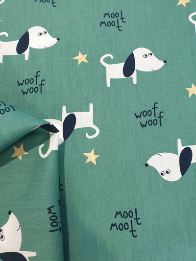 Puppy Print Fabric With Small Yellow Stars and Green Background
