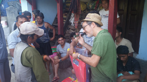 Joe Komodo distributing aid packs