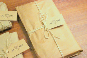 Packaging using locally sourced recycled craft paper.