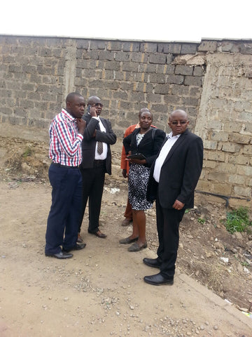 Officials from the Nairobi County Government inspect the entry point for storm water directed to South C by the management of Wilson Airport