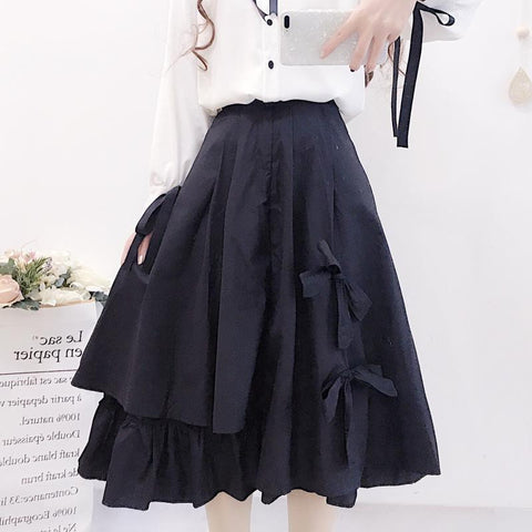BOW IRREGULAR MIDI SKIRT