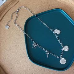 ANGEL CROSS HEART NECKLACE