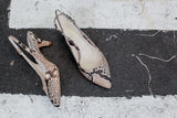 Kitten heel sling back shoes in snakeskin leather. Made in Italy.