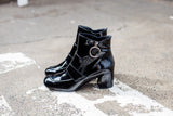 Portamento ankle boots in patent black leather. Made in Italy.