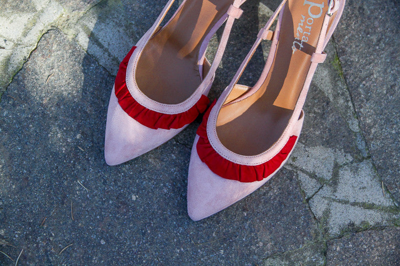 Slingback court kitten heel in soft pink suede leather with red ruffle.
