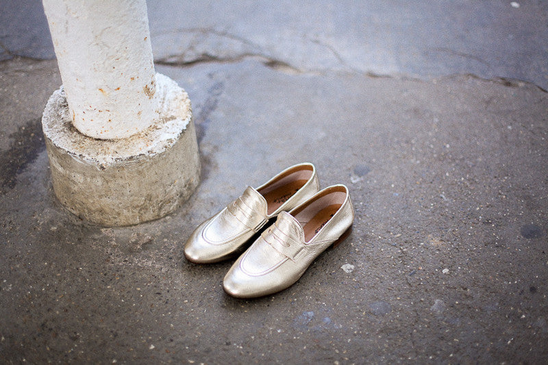 Metallic old gold leather loafers by Portamento.