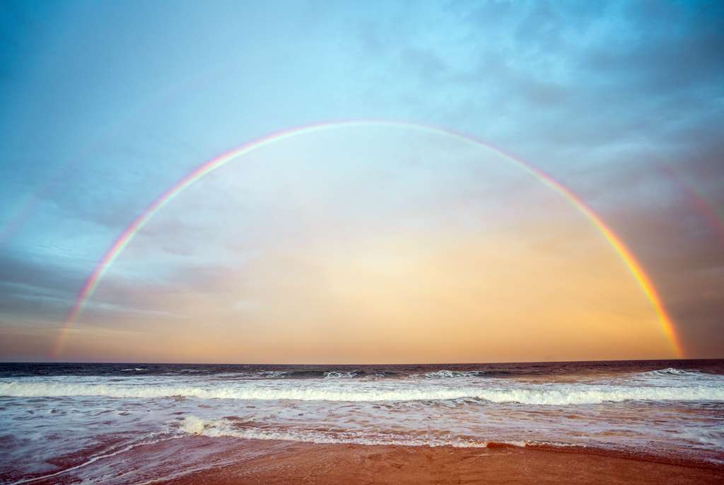 A double rainbow seen by the beach in the early morning