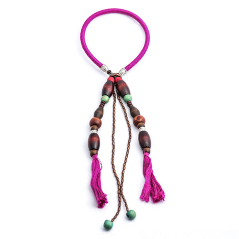 Fuschia tassle neck piece