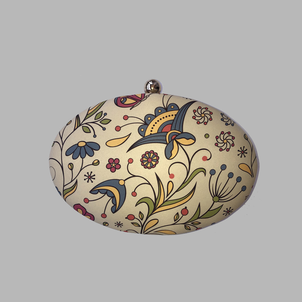 CREAM BASED PRINTED OVAL CLUTCH 8*5