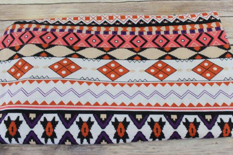 End of BOlt: 4 yards of Ethnic Orange and Purple Jersey Knit